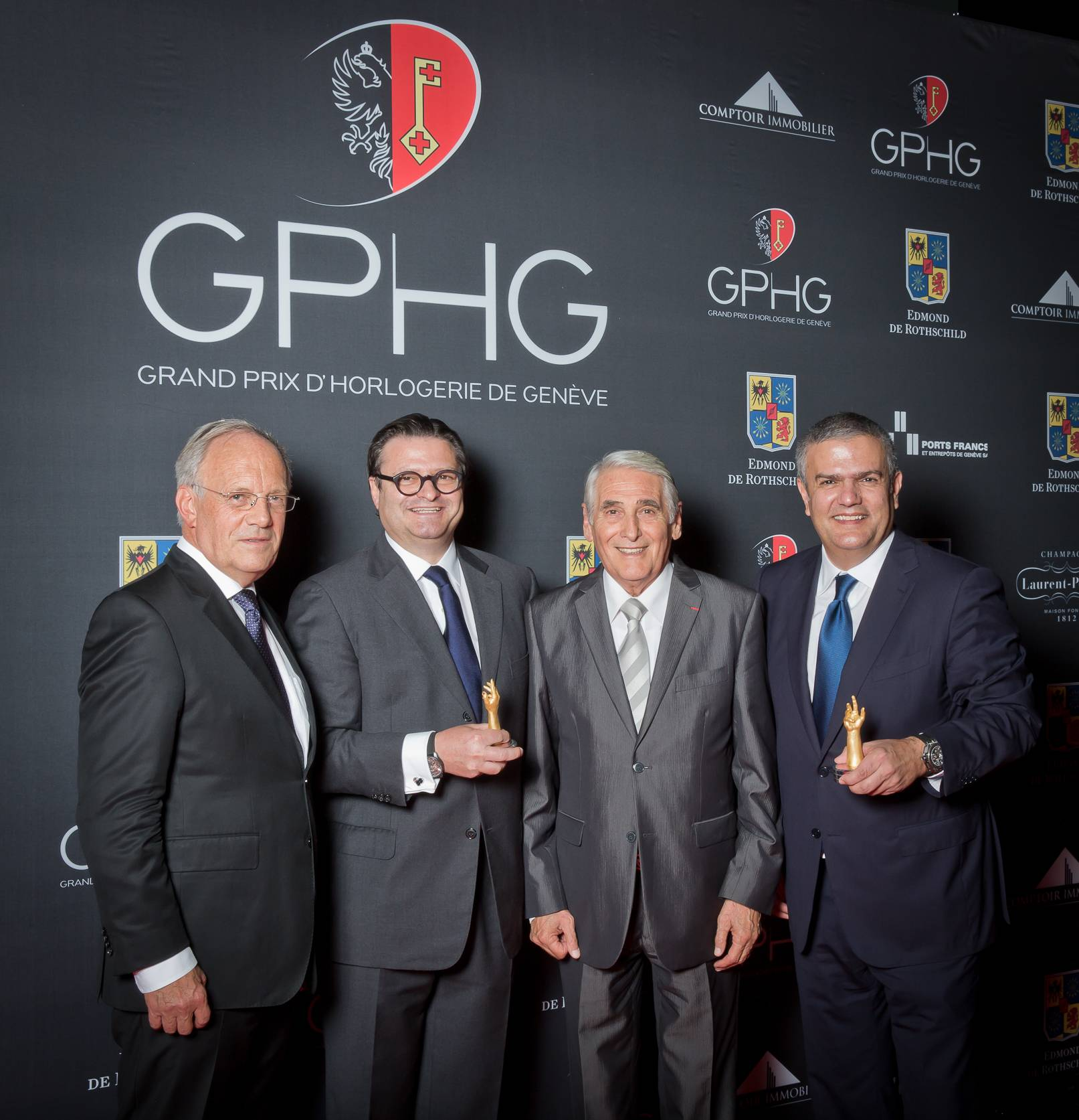 Johann Schneider-Ammann (Federal councillor), Aldo Magada (President & CEO of Zenith, winner of the Sports Watch Prize 2014), Carlo Lamprecht (President of the Foundation of the GPHG) and Ricardo Guadalupe (CEO of Hublot, winner of the Striking Watch Prize 2014)