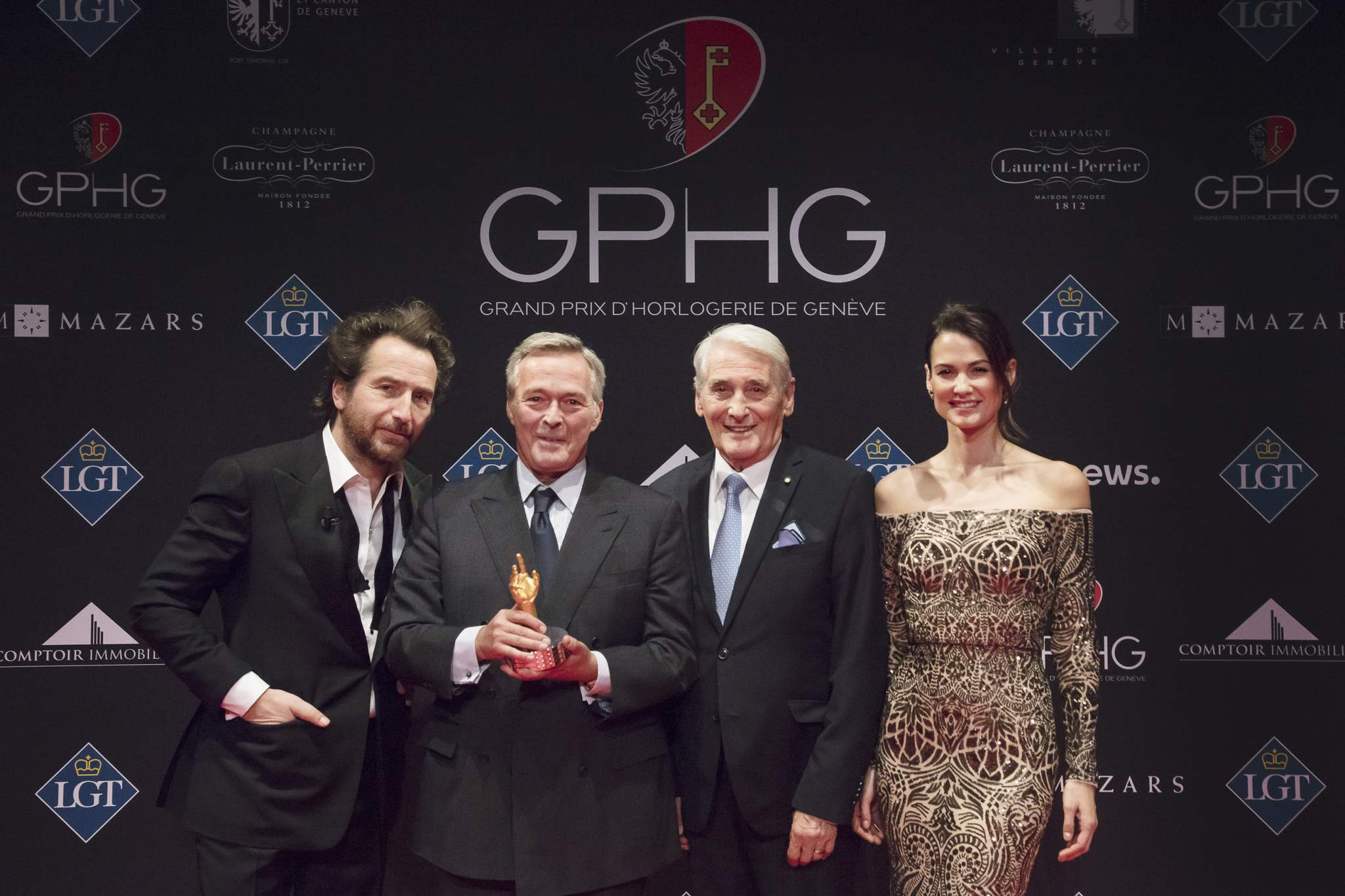 "Edouard Baer (MC), Karl-Friedrich Scheufele (Co-President of Chopard, winner of the ""Aiguille d'Or"" Grand Prix 2017 and the Jewellery Watch Prize 2017), Carlo Lamprecht (President of the GPHG Foundation) and Lauriane Gilliéron (MC)"