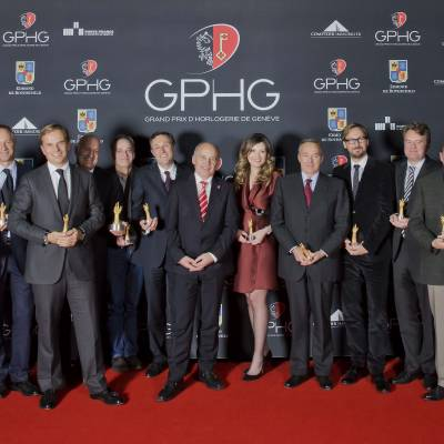 Winners of the Grand Prix d'Horlogerie de Genève 2013 : Carlo Lamprecht, Président of the GPHG, Richard and Maria Kristina Habring (CEO of Habring2), Wilhelm Schmid (CEO of A. Lange & Söhne), Jean-Frédéric Dufour (CEO of Zenith), Michele Sofisti (CEO of Girard-Perregaux), Vianney Halter (Founder), Philippe Peverelli (CEO of Tudor), Ueli Maurer, Président of the Swiss Confederation, Brigitte Morina (CEO of DeLaneau), Karl-Friederich Scheufele (Co-Président of Chopard), Nicolas Bos (CEO of Van Cleef & Arpels), Benoît Mintiens (Founder of Ressence), Kari Voutilainen (Founder of Voutilainen), Philippe Dufour, Nicolas Beau (International Director of Horlogerie at Chanel), Romain Gauthier (Founder)