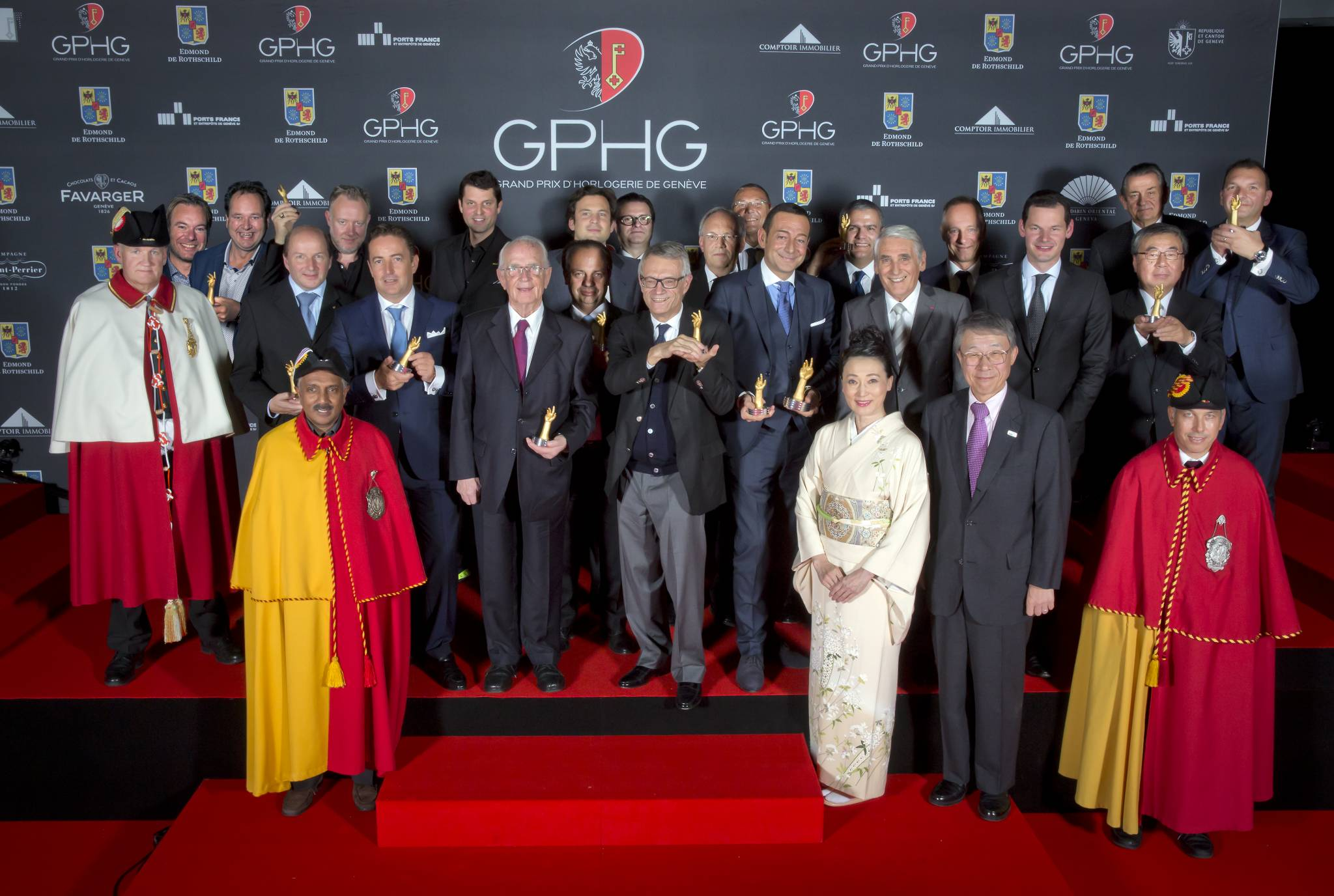 The Prize winners of the Grand Prix d'Horlogerie de Genève 2014 : Bart and Tim Grönefeld (Co-founders of Grönefeld), Kari Voutilainen (Founder of Voutilainen), Felix Baumgartner and Martin Frei (Co-founders of Urwerk), Pierre Jacques (CEO of De Bethune), Walter Lange (Founder of A. Lange & Söhne), Christophe Claret (Founder and president of Christophe Claret), Aldo Magada (President & CEO of Zenith), Dr Helmut Crott (Owner of Urban Jürgensen & Sonner), Johann Schneider-Ammann (Federal Counsellor), Jean-Christophe Babin (CEO of Bulgari), Jean-Charles Zufferey (Vice-president of Breguet), Ricardo Guadalupe (CEO of Hublot), Carlo Lamprecht (President of the Fondation of GPHG), Ryuhei Maeda (His Excellency Ambassador of Japan to in Switzerland) et Naoko Maeda, Wilhelm Schmid (CEO of A. Lange & Söhne), Pierre Maudet (State Councillor in Geneva), Stephen Urquhart (CEO of Omega), Susumu Kawanishi (Senior Vice-président of Seiko), Vincent Becchia (Product Director of Blancpain)